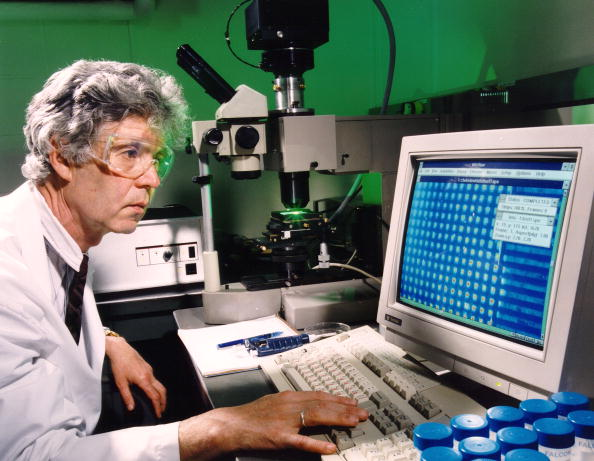 Scientist Viktor Barski of the Russian Engelhardt Institute of Molecular Biology studies the computer data from an Argonne-developed microchip used to speed sequencing of the human genome