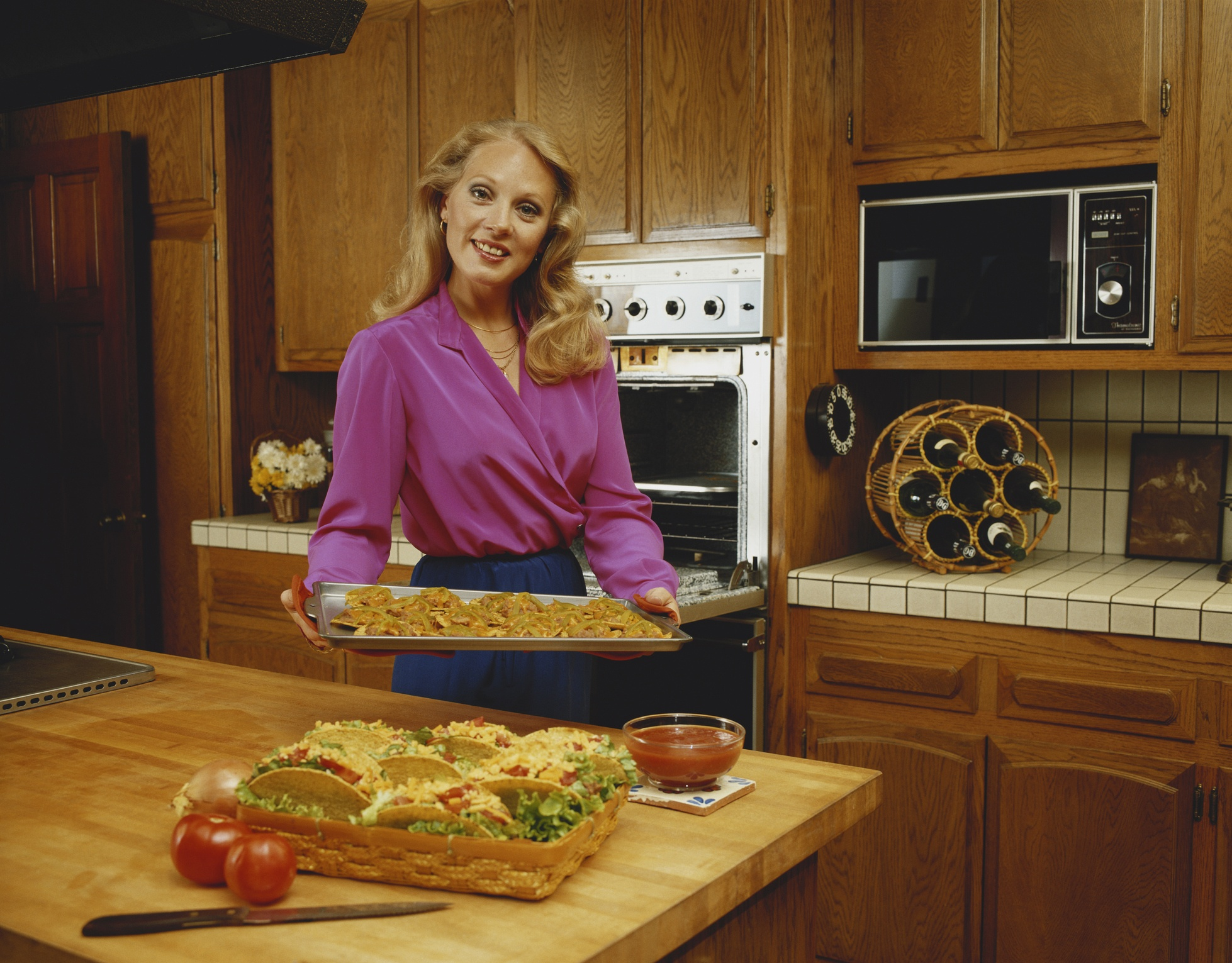 woman cooking in 1980s kitchen