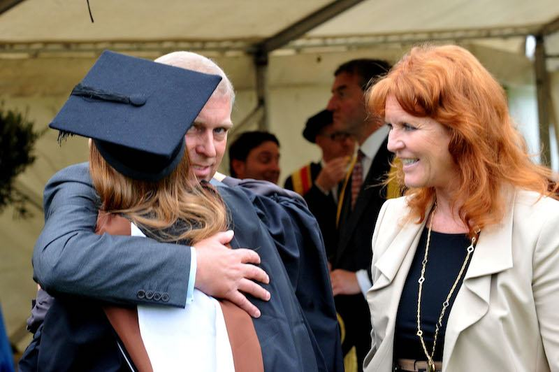 Prince Andrew, the Duke York (L), watched by Sarah, Duchess of York, hugs his daughter, Princess Beatrice