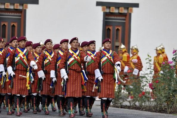 The Royal Guards of Honor take their positions at the TashichhoDzong in celebration of the wedding of The Royal Couple.
