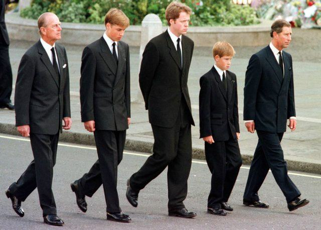 The Duke of Edinburgh, Prince William, Earl Spencer, Prince Harry and Prince Charles walk outside Westminster Abbey during the funeral service for Diana, Princess of Wales.