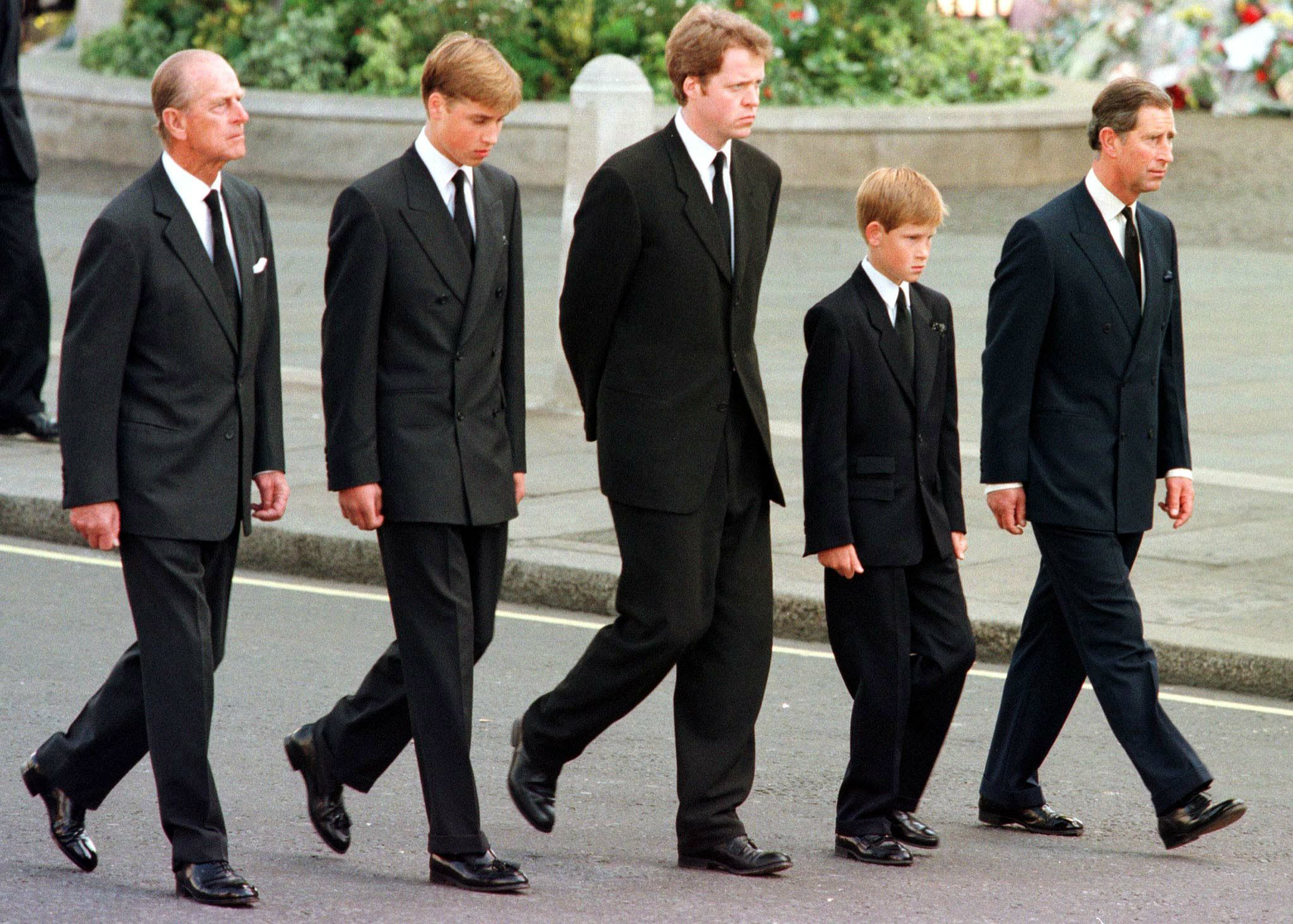 (L to R) The Duke of Edinburgh, Prince William, Earl Spencer, Prince Harry and Prince Charles walk outside Westminster Abbey during the funeral service for Diana, Princess of Wales.