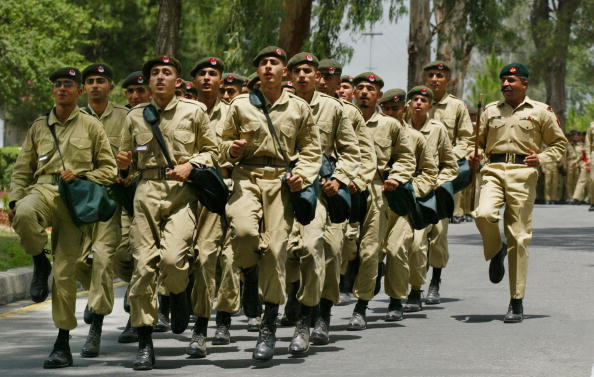 Pakistan military cadets train with their weapons during parade practice at the Pakistan Military Academy in Abbottabad, Pakistan.