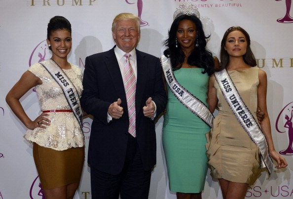 Donald Trump crowns the new Miss USA Nana Meriwether (C) alongside newly appointed Miss Universe Olivia Culpo (L) in 2013