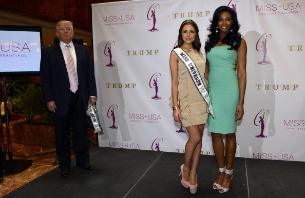 Donald Trump poses with new Miss USA Nana Meriwether (R) in 2013