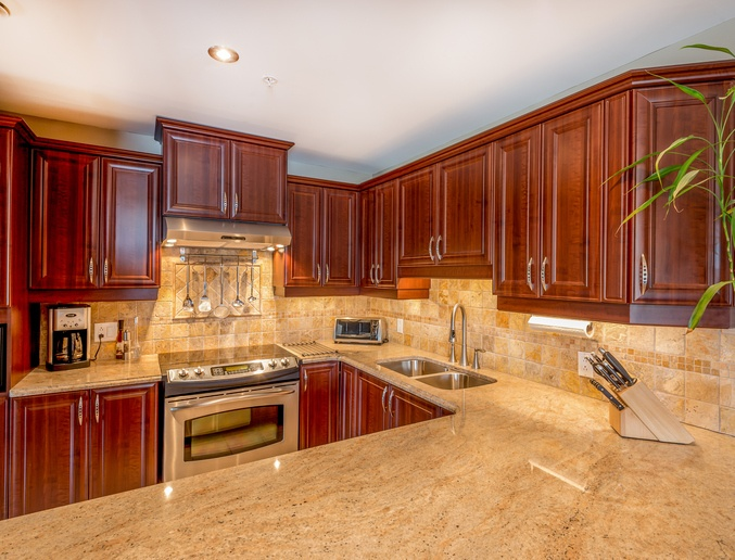 kitchen with granite and brown cabinets