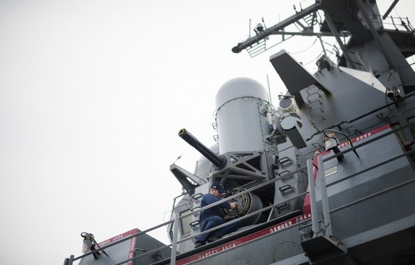 A sailor conducts maintenance on the Phalanx CIWS close-in weapon system aboard the Arleigh Burke-class guided missile destroyer USS Stout at Naval Station Norfolk in Norfolk, Virginia, May 8, 2013, during the Department of Defense's tour deemed Navy 101. AFP PHOTO/JIM WATSON