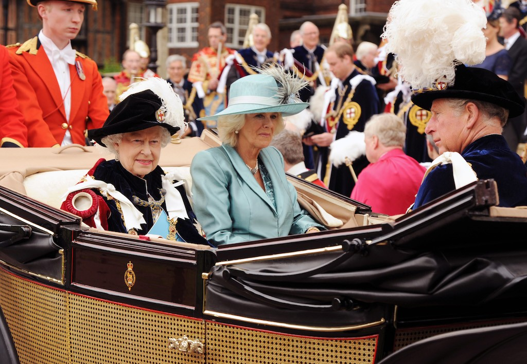 Queen Elizabeth and Camilla riding in a carriage