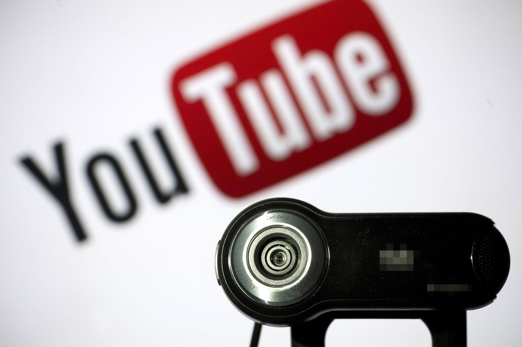 a webcam in front of the youtube logo