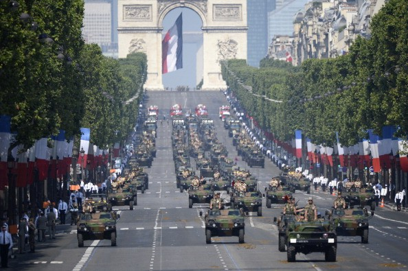 Members of the mechanised infantry march during the Bastille Day parade on the Champs Elysees avenue.