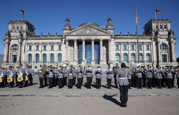 A military marching band performs prior to a swearing-in ceremony for new recruits of the Bundeswehr, the armed forces of the Federal Republic of Germany, in front of the Reichstag building.