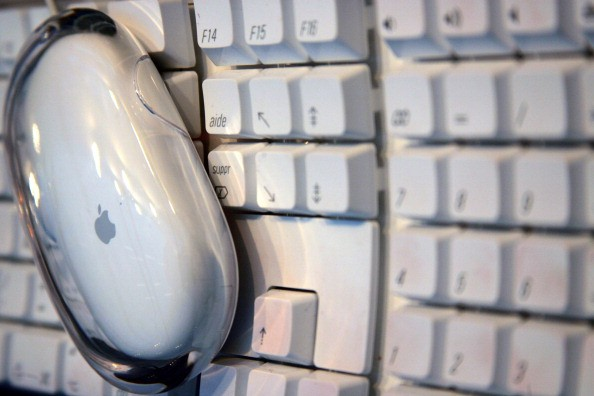 Apple computer mouse on a keyboard