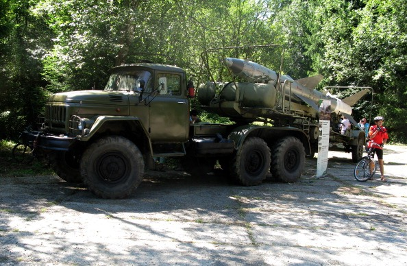 A visitor stands next to a soviet military truck with a missile at the Cold War museum in a a former Soviet nuclear warheads underground silo