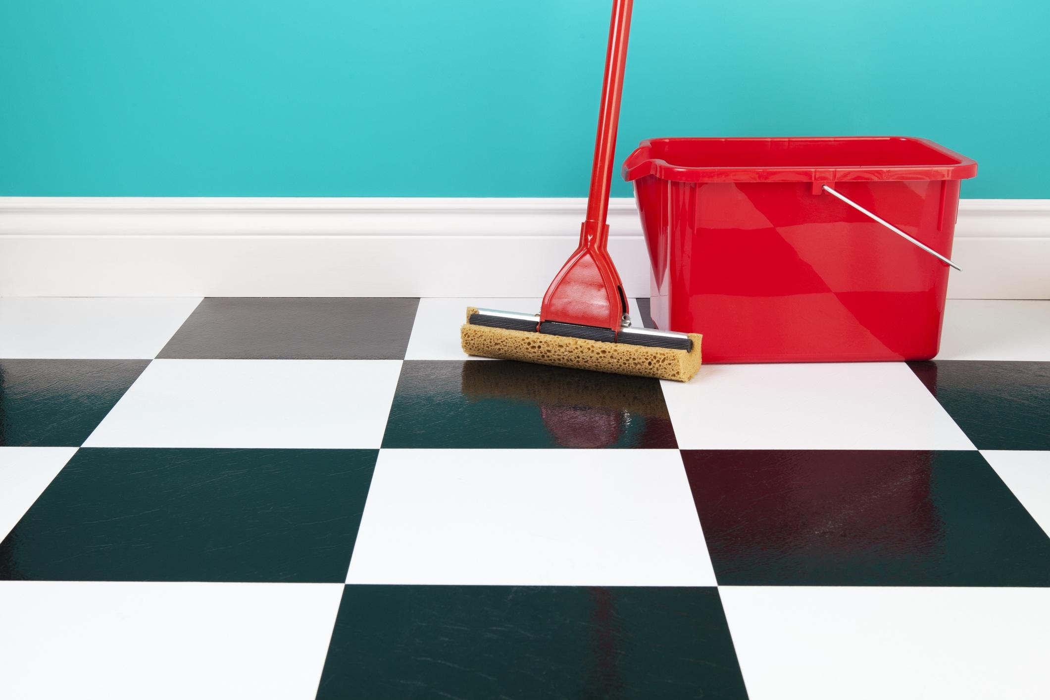 linoleum floor with mop and bucket