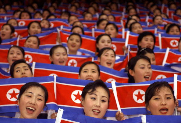North Korean cheer team members wave their national flags during the World Students Games opening ceremony in Daegu in 2003