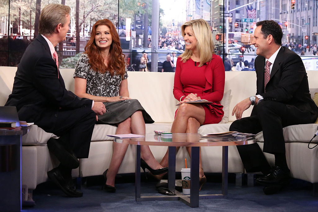 Debra Messing with Steve Doocy, Ainsley Earhard,t and Brian Kilmeade on Fox & Friends