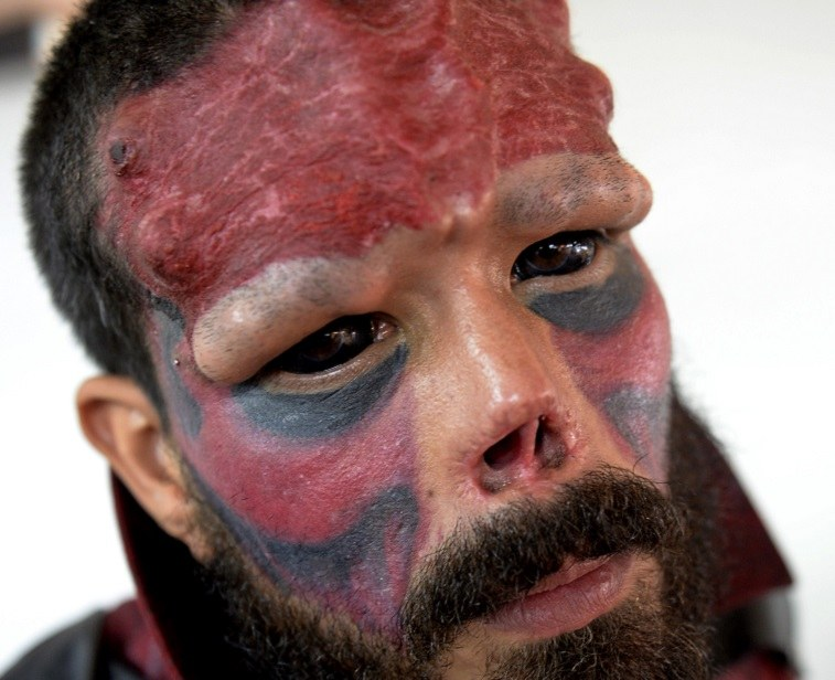 """Henry Damon, known as """"Red Skull,"""" poses during the """"Expo Tatoo Venezuela"""" in Caracas on January 29, 2015."""