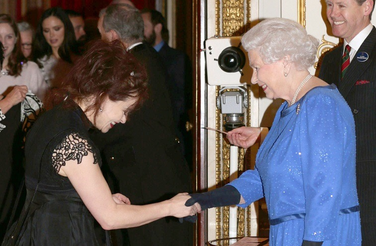 Queen Elizabeth II meets Helena Bonham Carter during the Dramatic Arts reception at Buckingham Palace on February 17, 2014 in London, England.