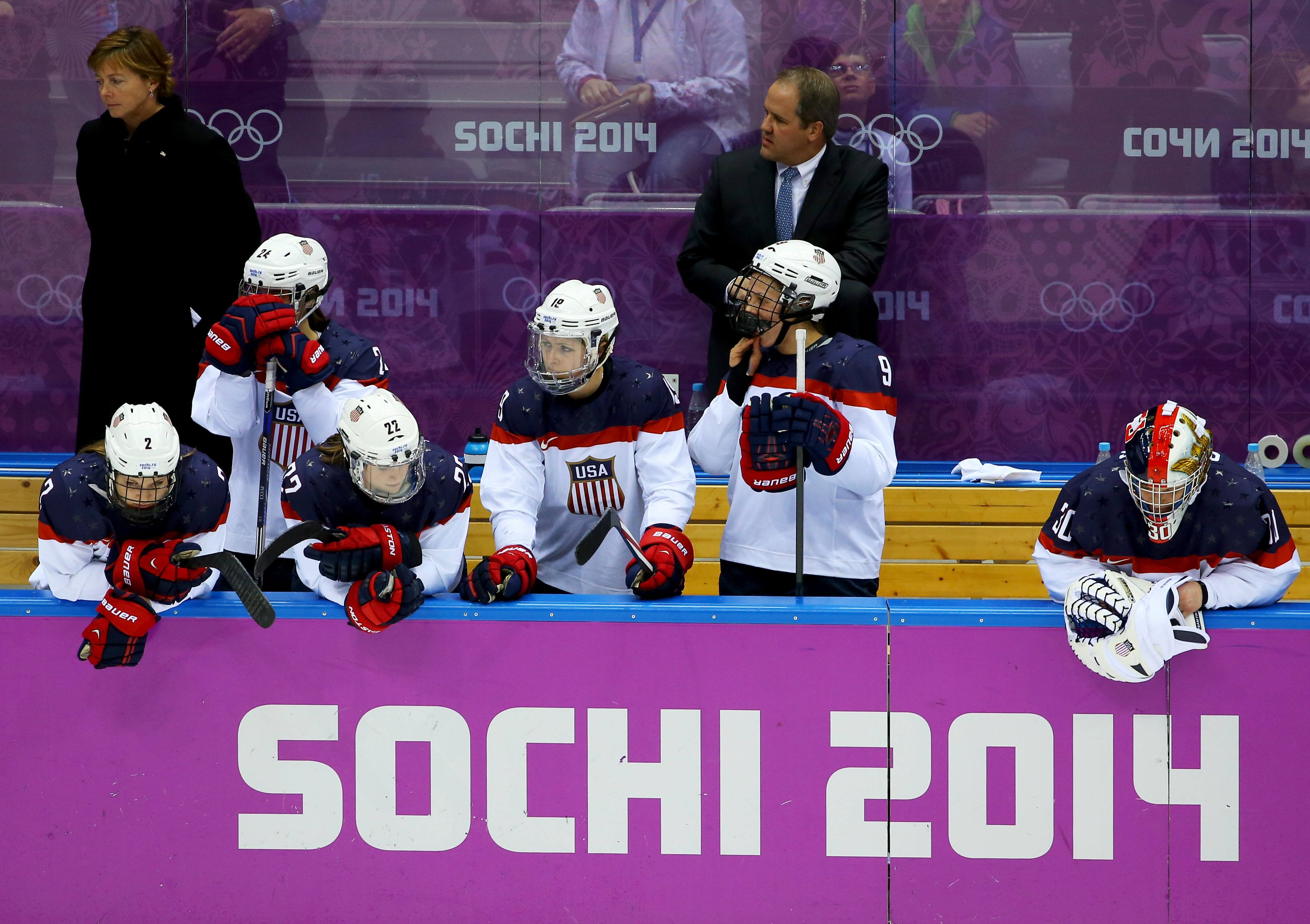 United States players look dejected as Canada win the gold medal during the Ice Hockey Women's Gold Medal Game on day 13 of the Sochi 2014 Winter Olympics at Bolshoy Ice Dome on February 20, 2014 in Sochi, Russia.
