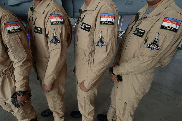 Egypt air force specially trained Rafale fighter jets pilots pose at an air base.