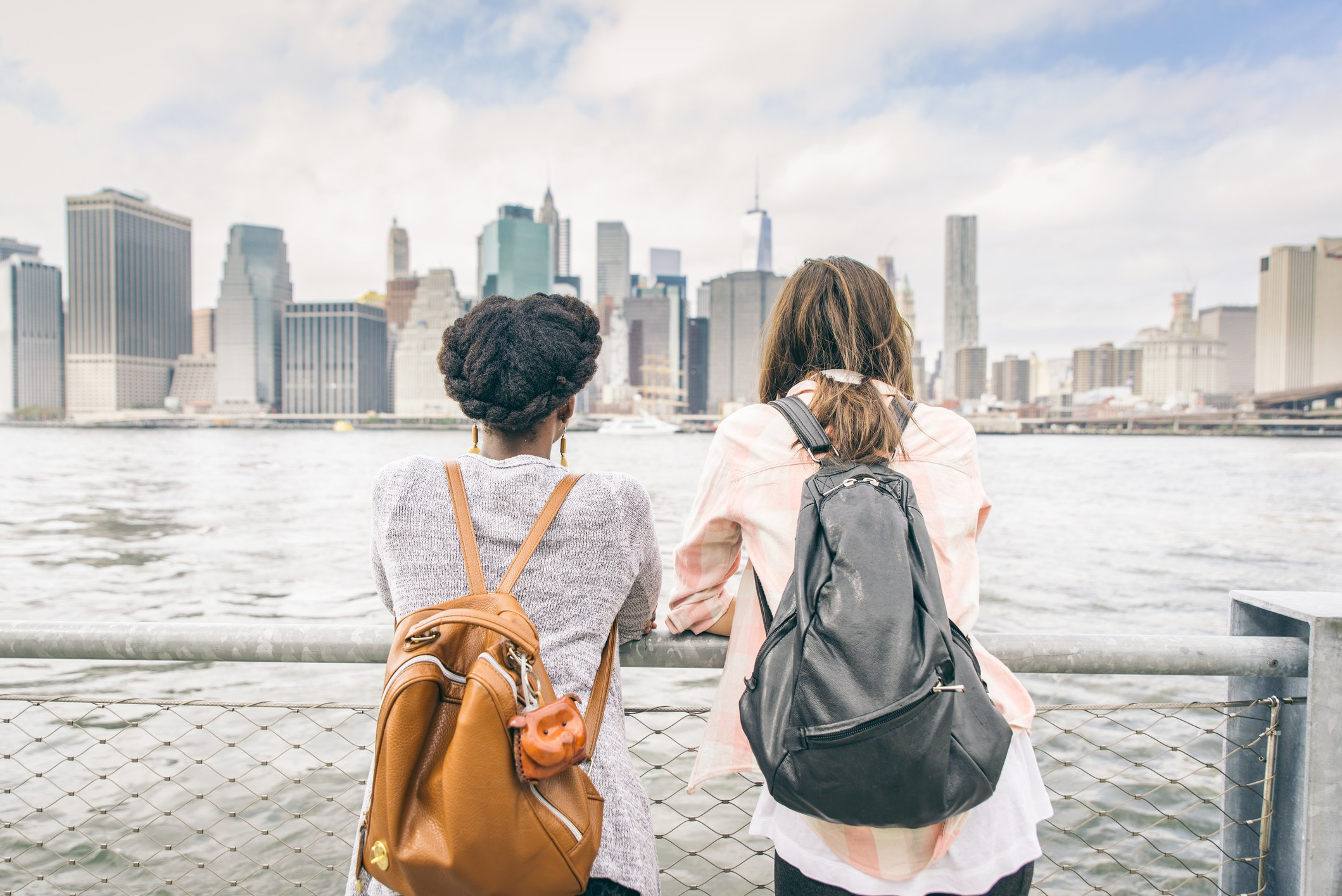 Two women looking at New York's skyline