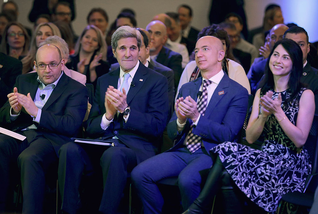 Washington Post reporter and former Tehran bureau chief Jason Rezaian, former U.S. Secretary of State John Kerry, Jeff Bezos and his wife MacKenzie Bezos participate in the opening ceremony of the newspaper's new location