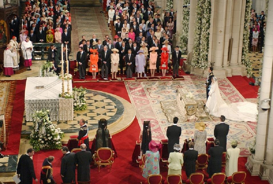 Spain's Crown Prince Felipe de Bourbon stands next to his bride Letizia Ortiz as they marry in Almudena cathedral