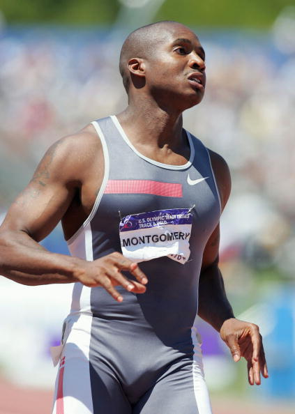 Tim Montgomery competes in the men's 100 Meter Dash Semifinals during the Olympics.