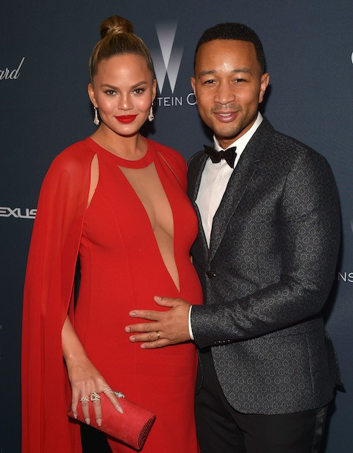 Model/TV personality Chrissy Teigen (L) and recording artist John Legend attend The Weinstein Company's Pre-Oscar Dinner