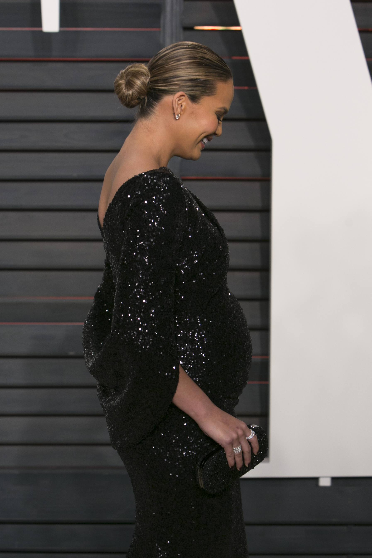 US model Chrissy Teigen poses as she arrives to the 2016 Vanity Fair