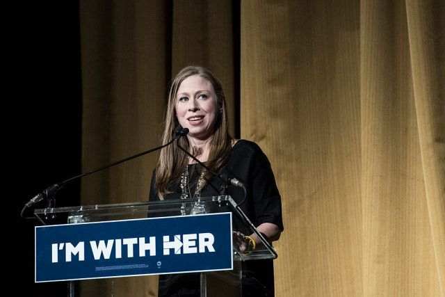 Chelsea Clinton speaking at a podium.