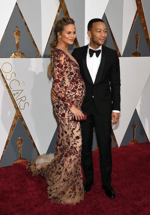 Model Chrissy Teigen (L) and recording artist John Legend attend the 88th Annual Academy Award