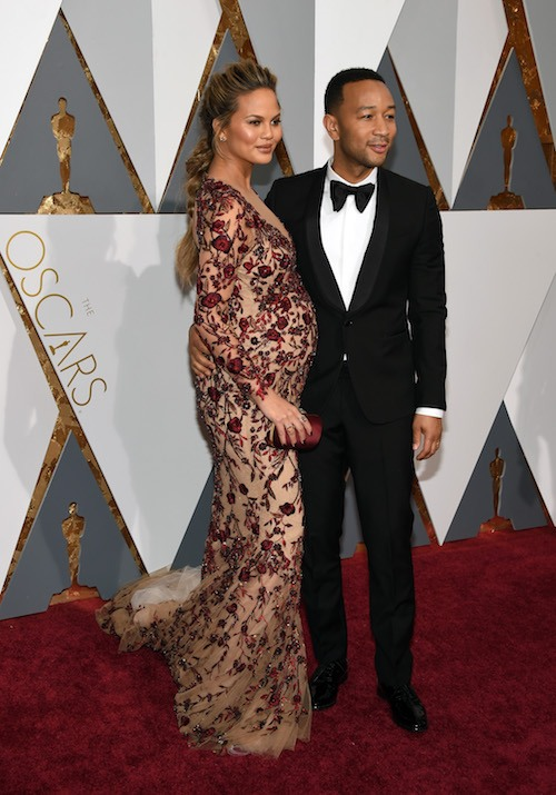Model Chrissy Teigen (L) and recording artist John Legend attend the 88th Annual Academy Award