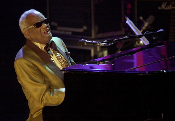ray charles in gold at the piano