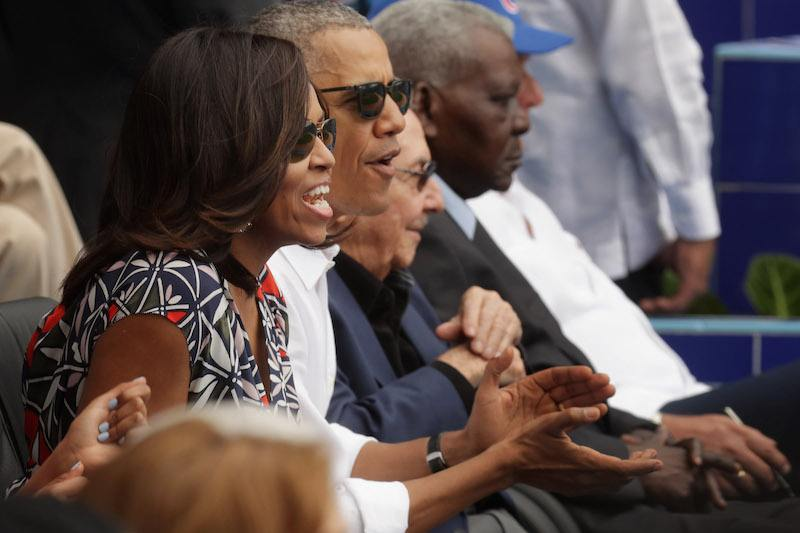 HAVANA, CUBA - MARCH 22: (L-R) U.S. first lady Michelle Obama, President Barack Obama and Cuban President Raul Castro react to the first run scored during an exhibition game between the Cuban national baseball team and Major League Baseball's Tampa Bay Devil Rays at the Estado Latinoamericano March 22, 2016 in Havana, Cuba. This is the first time a sittng president has visited Cuba in 88 years. (Photo by Chip Somodevilla/Getty Images)