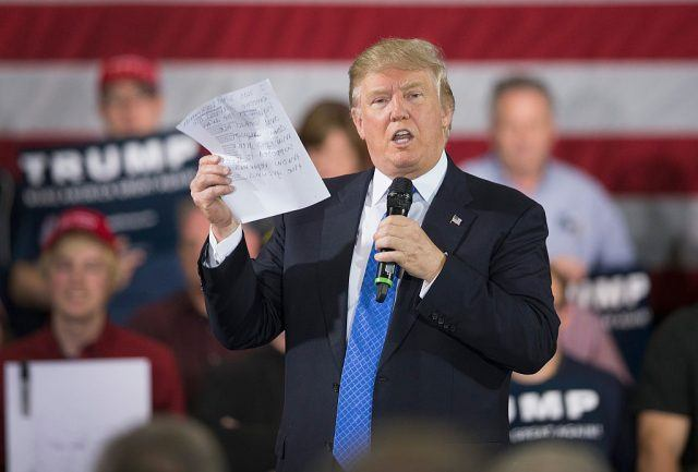 During a campaign rally, Donald Trump reads a statement made by Michelle Fields.