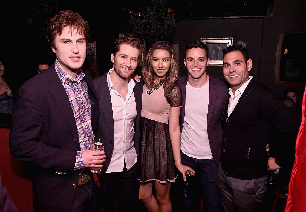 a group of politico reporters at a cocktail party