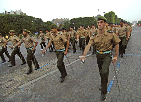 A Brazilian Army marching troop walks on the Champs-Elysees Avenue in Paris