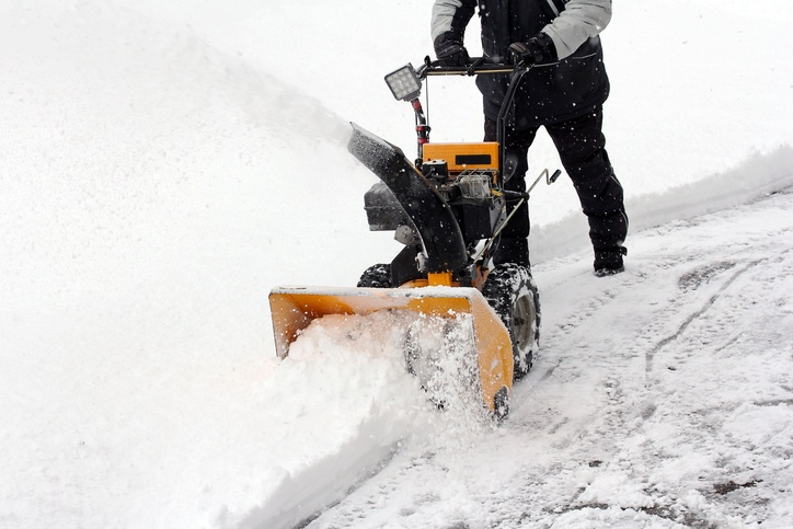 person using a snow blower