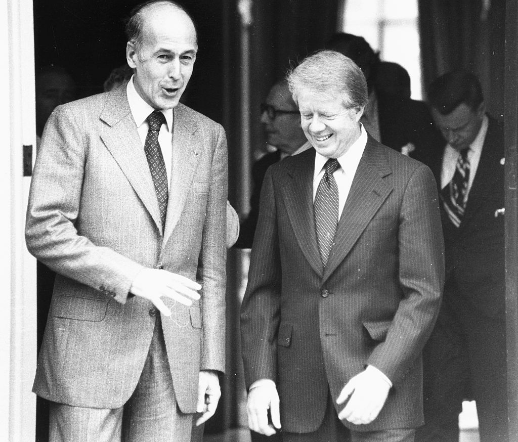 French President Valery Giscard d'Estaing (left) talking to Jimmy Carter as they leave the French Ambassadors residence in London, May 9, 1977.