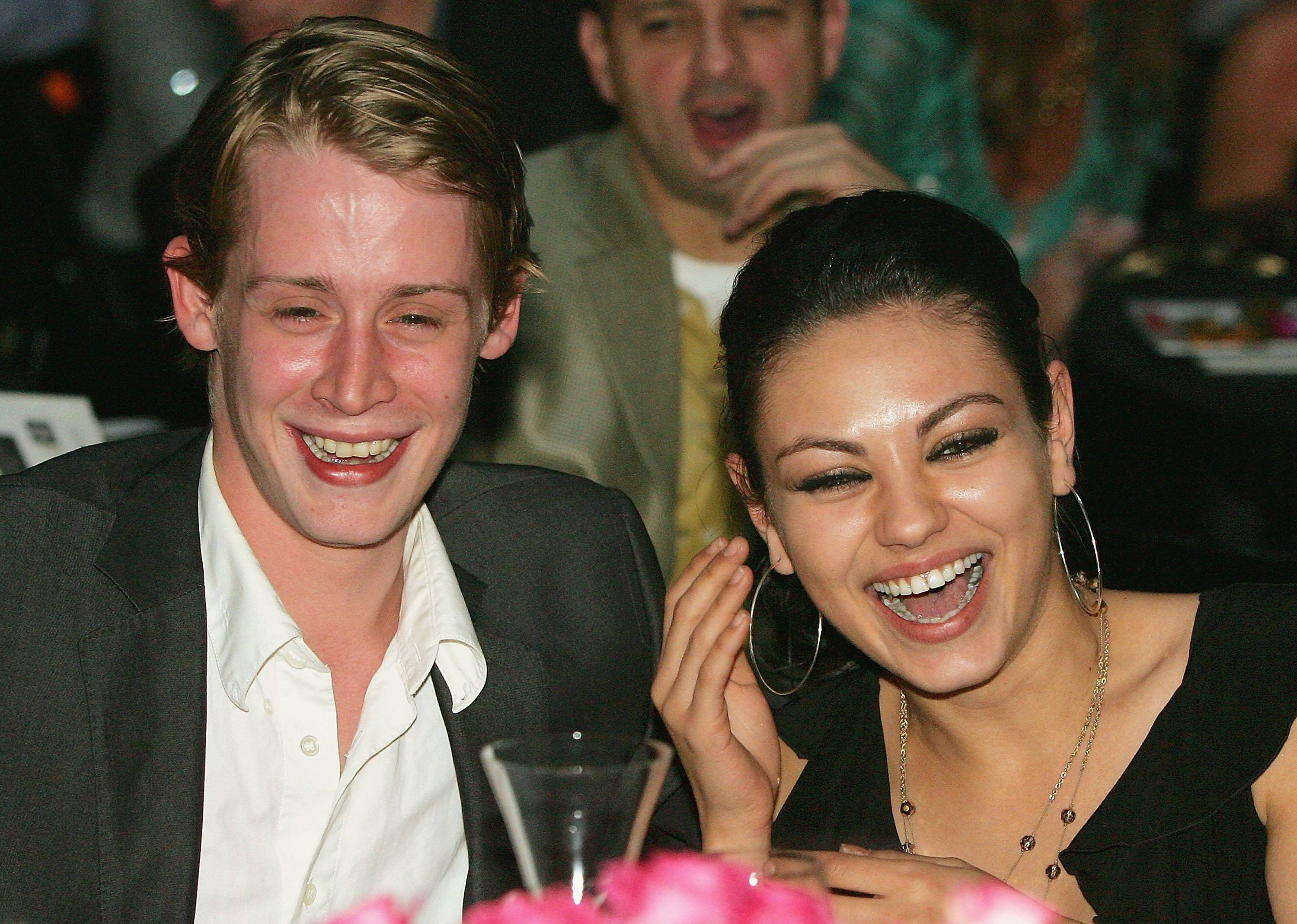 Macaulay Culkin and Mila Kunis laughing together