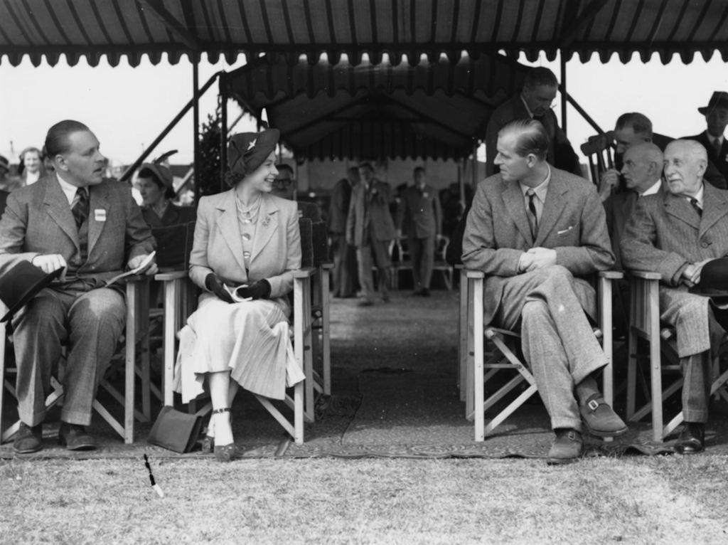 Princess Elizabeth talking to Prince Philip, the Duke of Edinburgh, at the Royal Horse Show at Windsor, England, May 12th 1949.