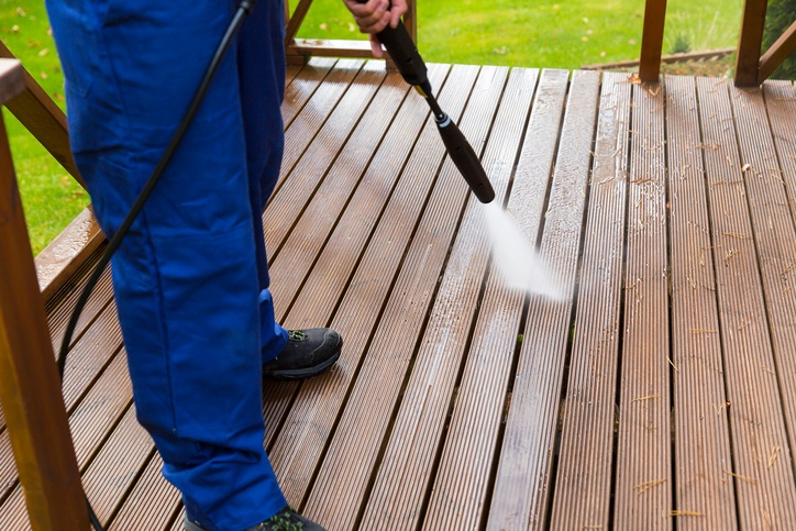 cleaning a deck with a pressure washer