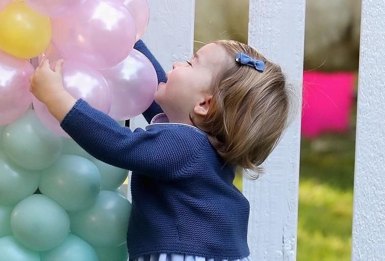Princess Charlotte hugging balloons