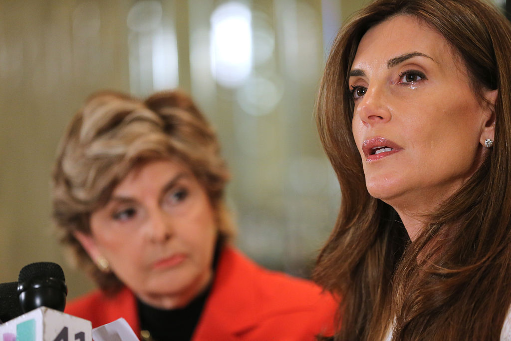 Gloria Alfred and Karena Virginia speak during a press conference where Karena Virginia identified herself as victim of sexual misconduct by Republican Presidential Candidate Donald Trump at a press conference at The London Hotel on October 20, 2016 in New York City. Karena Virginia states that she was a victim of inappropriate contact during an encounter with Donald Trump at the 1998 U.S. Open Tennis Tournament in the Flushing neighborhood of the Queens borough of New York Cit