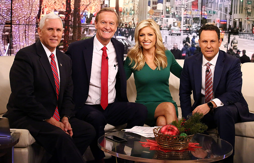 Mike Pence poses with Fox & Friends hosts, Steve Doocy, Ainsley Earhardt and Brian Kilmeade