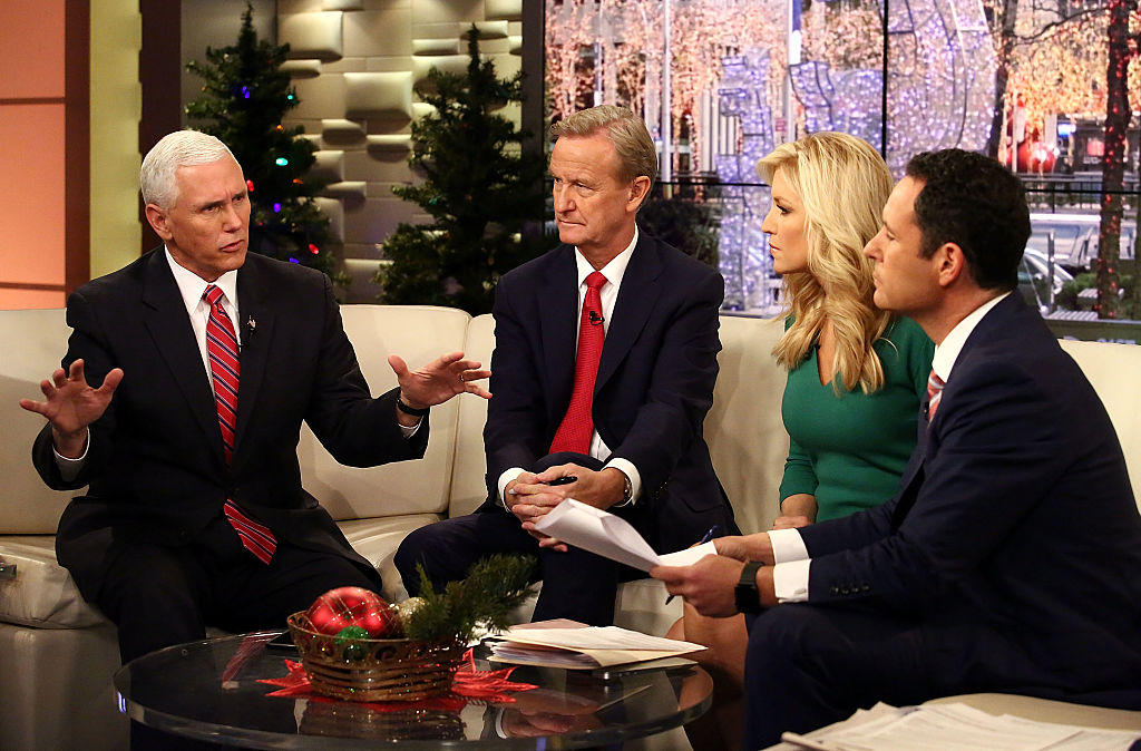 Vice President-Elect Mike Pence talks with Fox & Friends hosts, Steve Doocy, Ainsley Earhardt and Brian Kilmeade at Fox News Studios on December 6, 2016 in New York City.