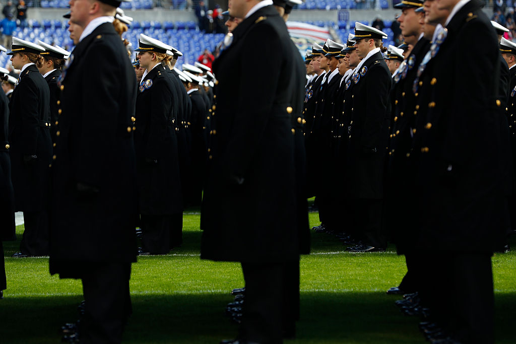 Cadets from the U.S. Naval Academy line up on field prior to the game between the Navy Midshipmen and the Army Black Nights at M&T Bank Stadium in Baltimore, Maryland.