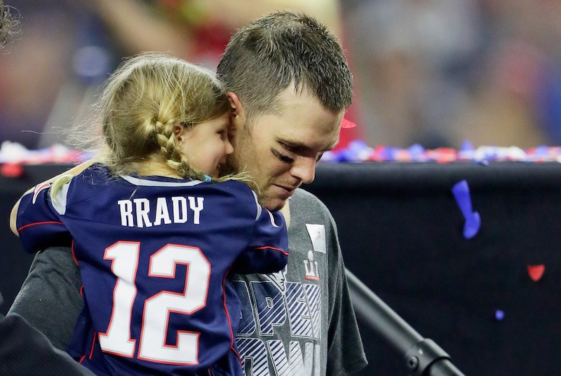 om Brady #12 of the New England Patriots celebrates with his daughter Vivian after defeating the Atlanta Falcons 34-28 in overtime to win Super Bowl 51 at NRG Stadium on February 5, 2017 in Houston, Texas.
