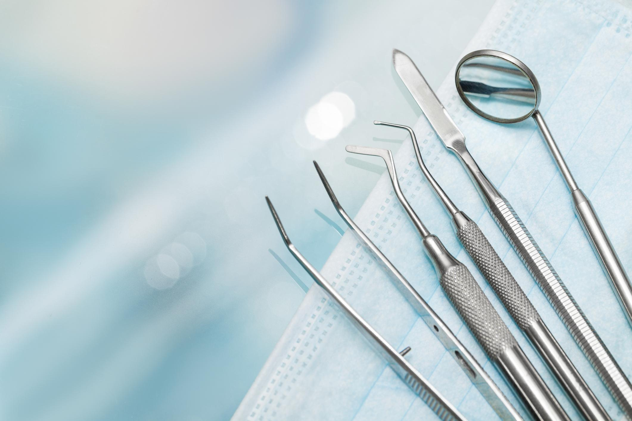 Set of metal dentist's medical equipment tools